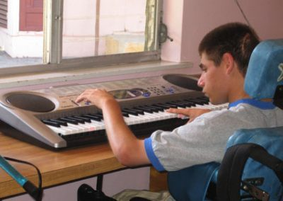 Hillside resident playing music on a keyboard