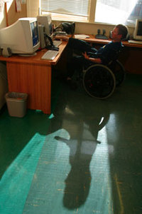 Man in wheelchair using a computer