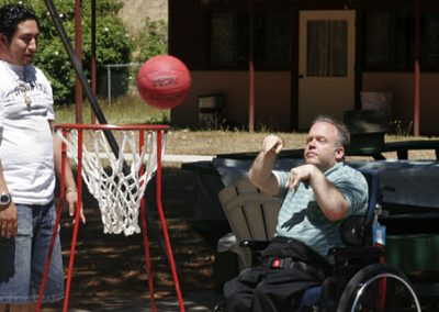 Hillside resident playing basketball from a wheelchair