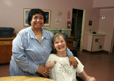 Volunteer smiling with resident